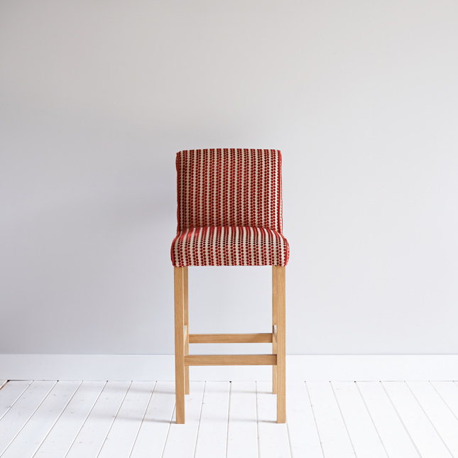 Oak Breakfast stool with red and white pattered upholstery