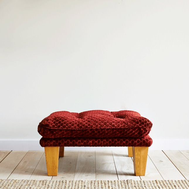 Deep buttoned cushioned footstool