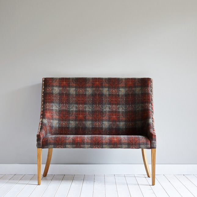 Cleatop bench upholstered in tartan fabric