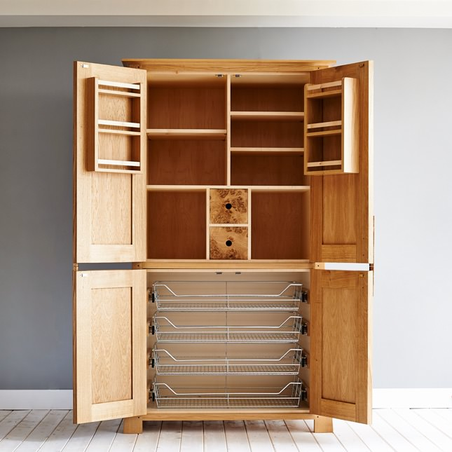 The Curved Larder Cupboard with it's doors open, revealing multiple storage options