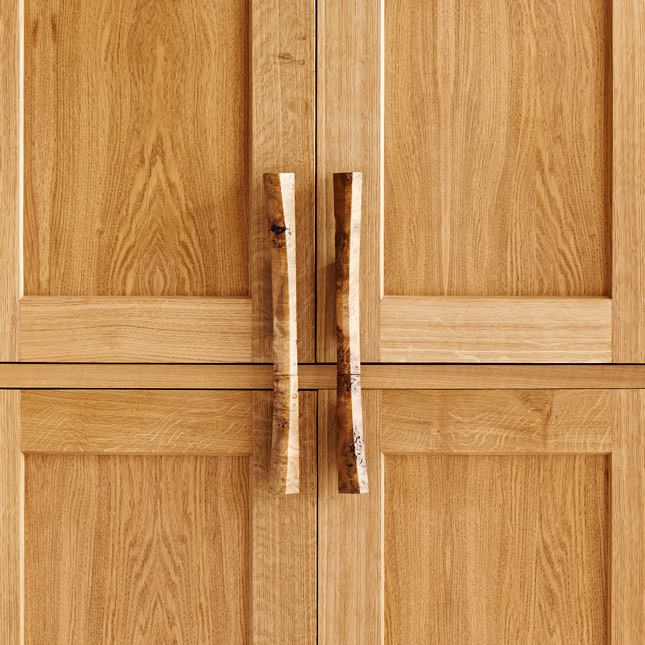 Closeup view of Burr oak handles on the Curved Larded Cupboard