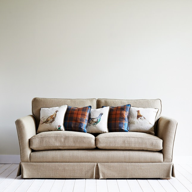 Uniquely designed cushions on a sofa
