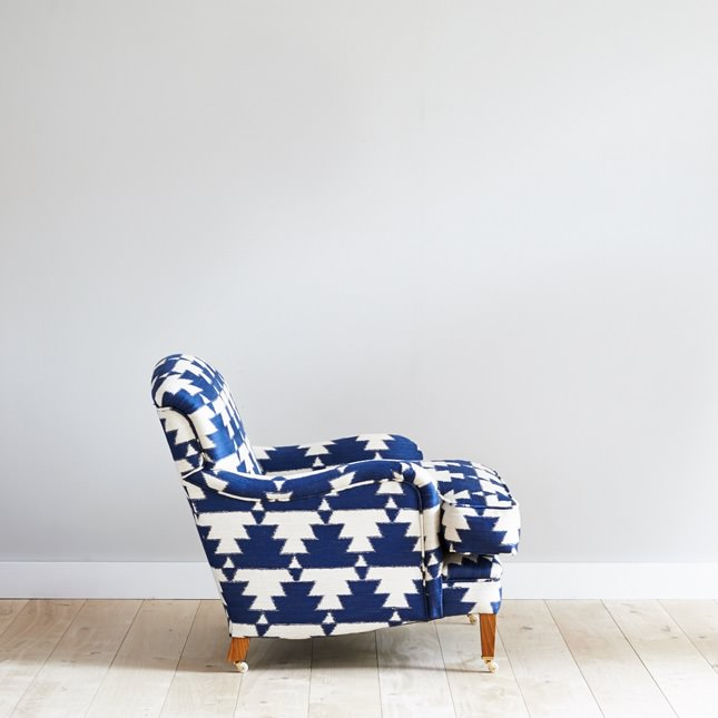 Side view of Kalkaber arm chair in bold blue and white upholstery
