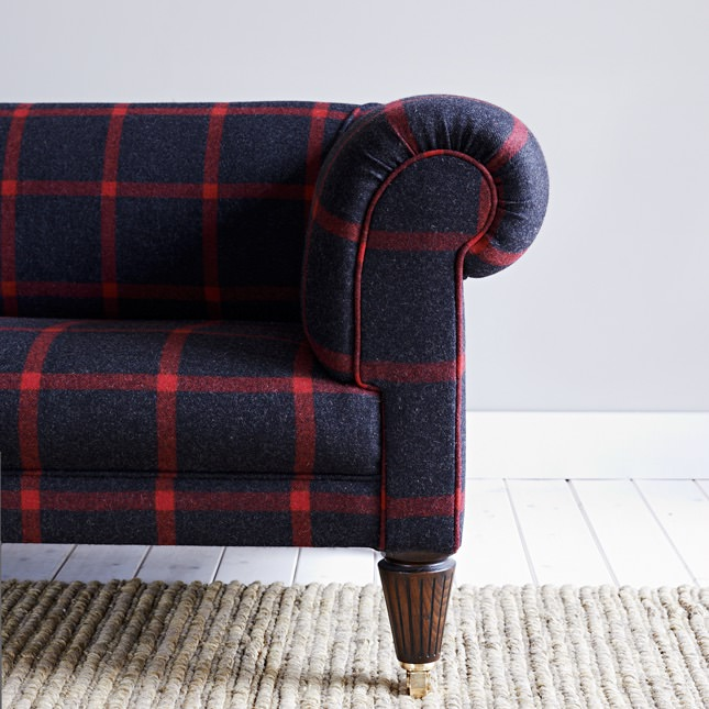 Detailed view of Laraber sofa in Navy and Red upholstery