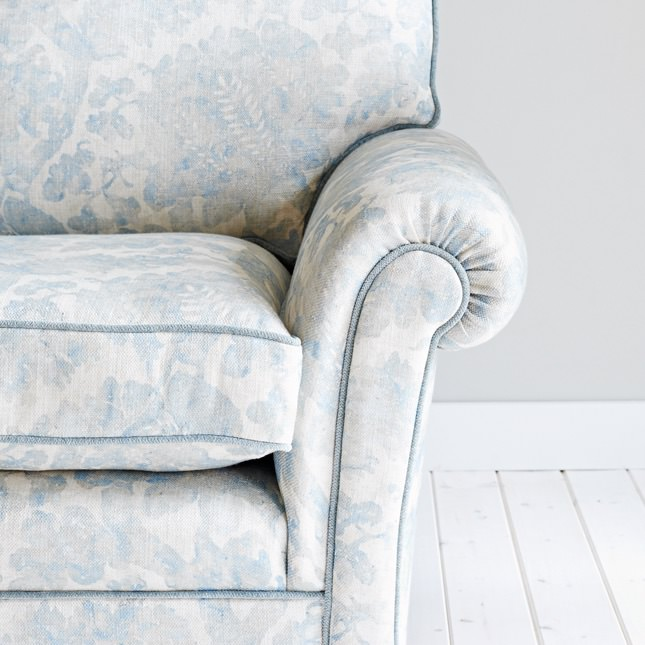 Close up view of scroll arms on Norber Sofa