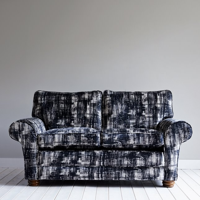 Norber Sofa in black and white fabric upholstery