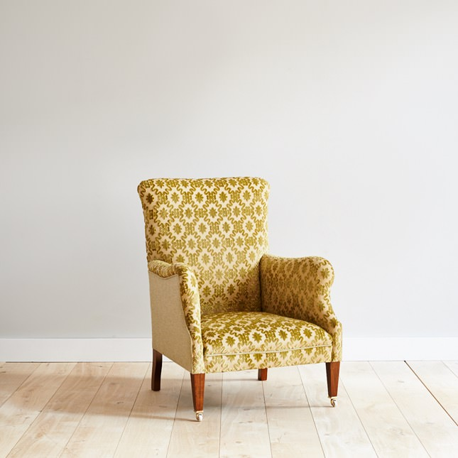 Angled view of Dalesbred Tranbury chair in mustard upholstery